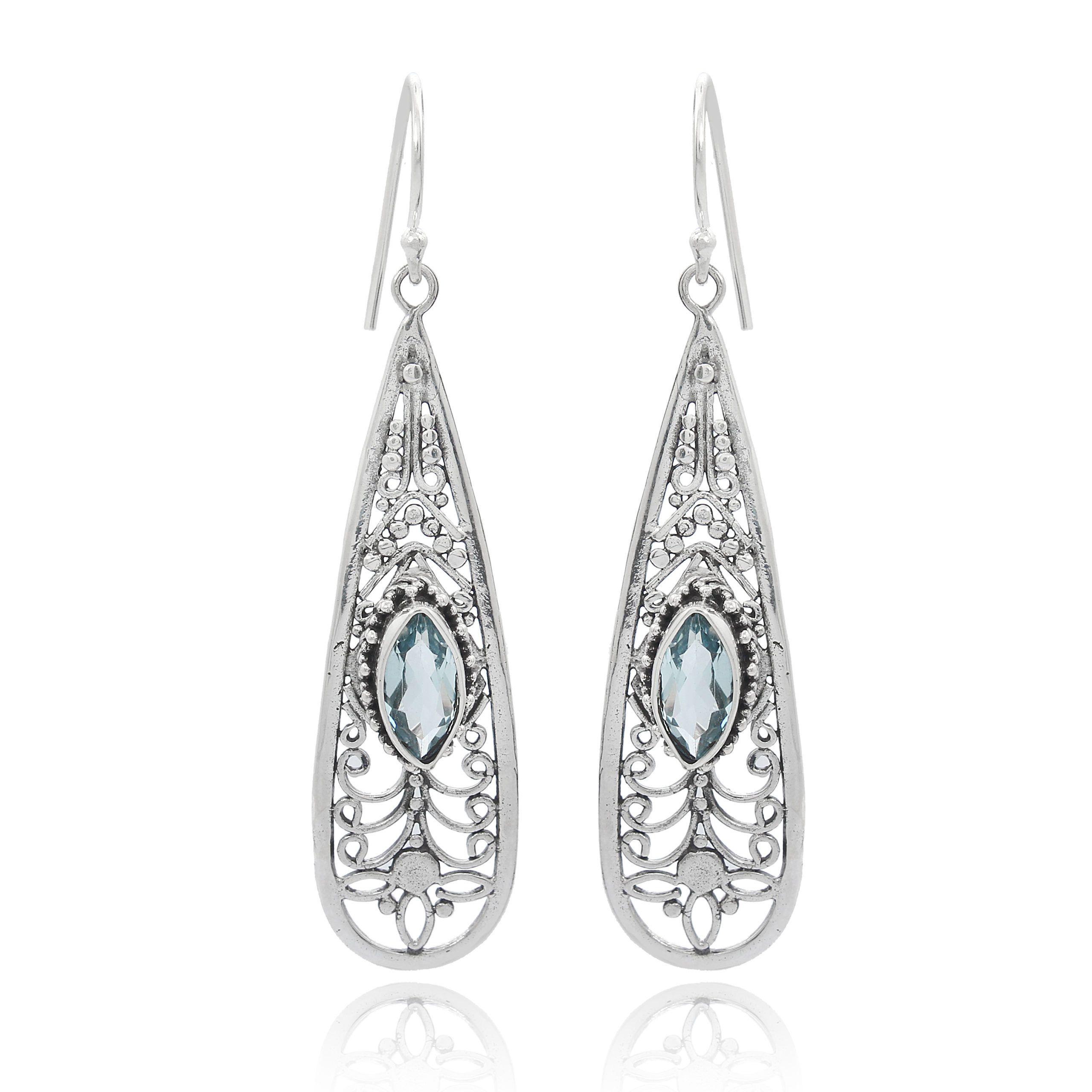 Pendientes largos de plata con topacio azul natural Shadi